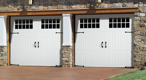 Openings in carriage house style looks can be deceiving for Carriage style garage doors cost
